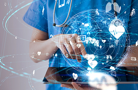 Doctor enters data into her tablet and uses secure communication through LANCOM