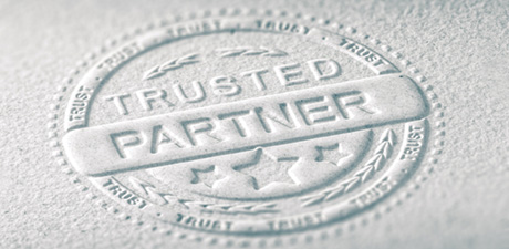"Stamp imprint on paper with inscription ""Trusted Partner"""